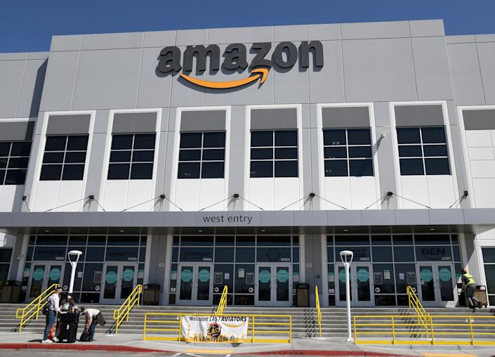NORTH LAS VEGAS, NEVADA - MARCH 31:  An exterior view shows an Amazon fulfillment center on March 31, 2021 in North Las Vegas, Nevada. The company is offering employees COVID-19 vaccinations at the facility for eight days.  (Photo by Ethan Miller/Getty Images)