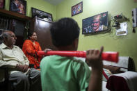"""An Indian family watches epic television series """"Ramayan"""" at their home in Jammu, India May 18, 2020. The country's public broadcaster last month revived the wildly popular series from the 80s and brought back to life for a captive audience under lockdown. Staying home under a lockdown as they wait for the worst of the coronavirus pandemic to pass, millions of Indians are turning to their Gods. Not in their prayer rooms, but on their televisions. (AP Photo/Channi Anand)"""