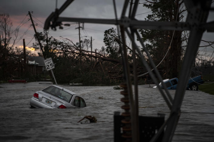 <p>A car is seen caught in flood water after category 4 Hurricane Michael made land fall along the Florida panhandle, on Wednesday, Oct. 10, 2018 in Panama City, Fla. (Photo: Jabin Botsford/The Washington Post via Getty Images) </p>