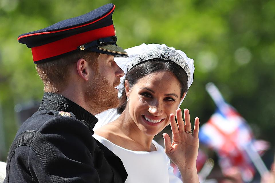 Britain's Prince Harry, Duke of Sussex and his wife Meghan, Duchess of Sussex wave from the Ascot Landau Carriage during their carriage procession on the Long Walk as they head back towards Windsor Castle in Windsor, on May 19, 2018 after their wedding ceremony. (Photo by Daniel LEAL-OLIVAS / AFP)        (Photo credit should read DANIEL LEAL-OLIVAS/AFP via Getty Images)