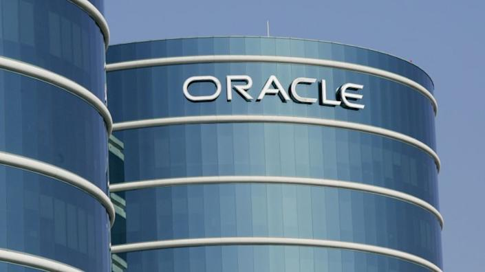 ** FILE **An exterior view of Oracle Corp. headquarters is shown in a Redwood City, Calif. file photo from Feb. 9, 2006. Business software maker Oracle Corp. is expected to post a fourth-quarter profit before certain costs of 28 cents a share on sales of $4.7 billion, the average estimates in a survey of analysts. (AP Photo/Paul Sakuma, File) ORG XMIT: NYBZ102