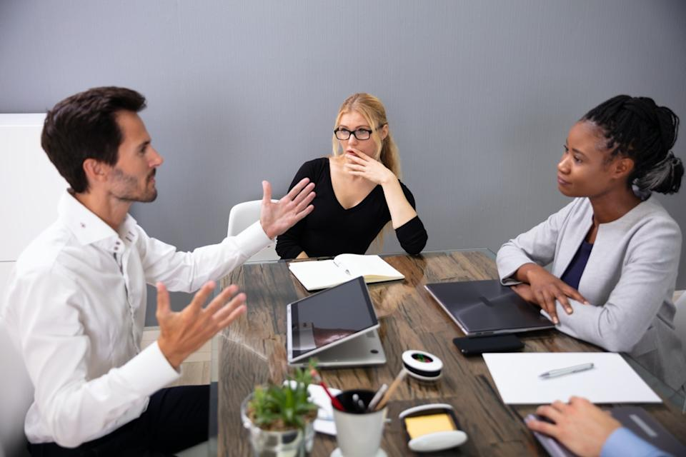 Man and two women in business meeting