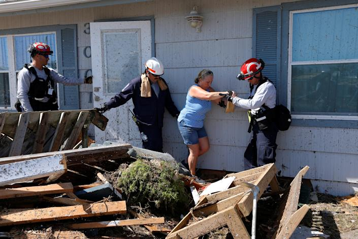 <p>Bianna Kelsay is rescued from a building damaged by Hurricane Michael in Mexico Beach, Fla., Oct. 11, 2018. (Photo: Jonathan Bachman/Reuters) </p>