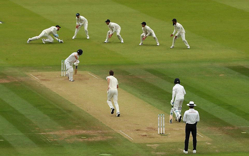 Captain William Porterfield of Ireland is caught out by Jonny Bairstow of England off the bowling of Chris Woakes of England during day three of the Specsavers Test Match between England and Ireland at Lord's Cricket Ground on July 26, 2019 in London, England - Julian Finney/Julian Finney