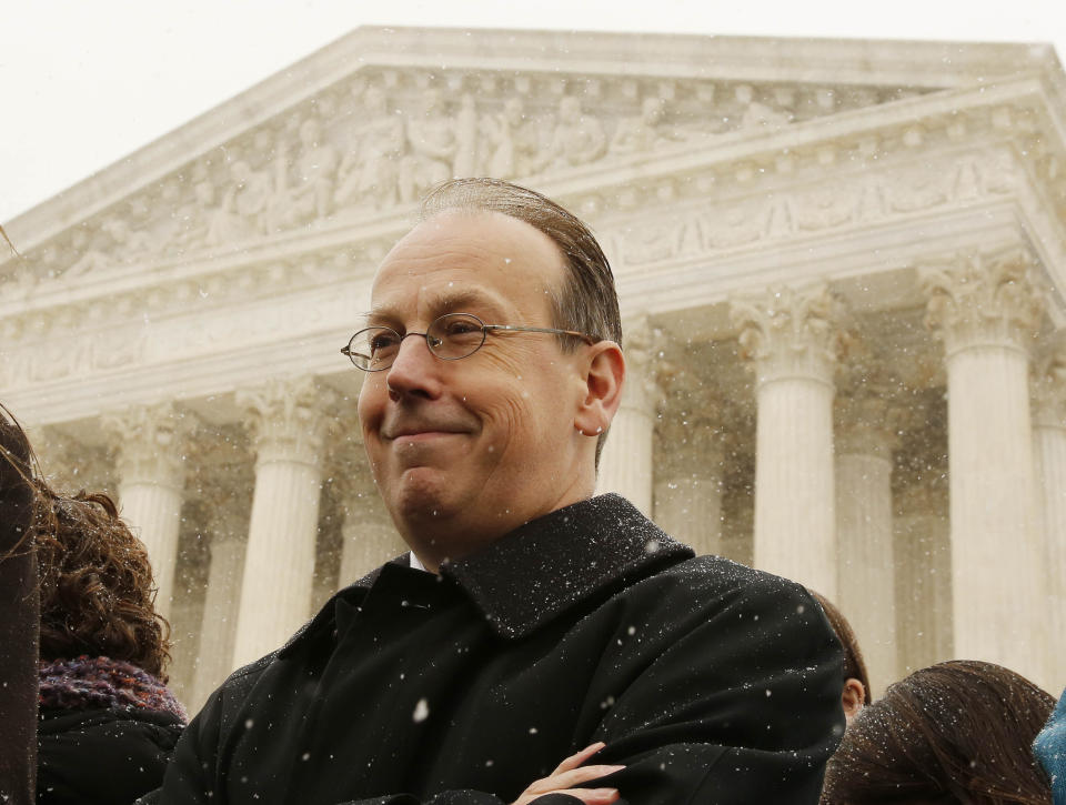 Attorney Paul Clement waits to talk to the press standing on the steps of the Supreme Court in Washington, after presenting arguments to challenge the Affordable Care Act's requirement that employers provide coverage for contraception as part of an employee's health care, March 25, 2014.      REUTERS/Larry Downing (UNITED STATES - Tags: POLITICS HEALTH BUSINESS RELIGION)