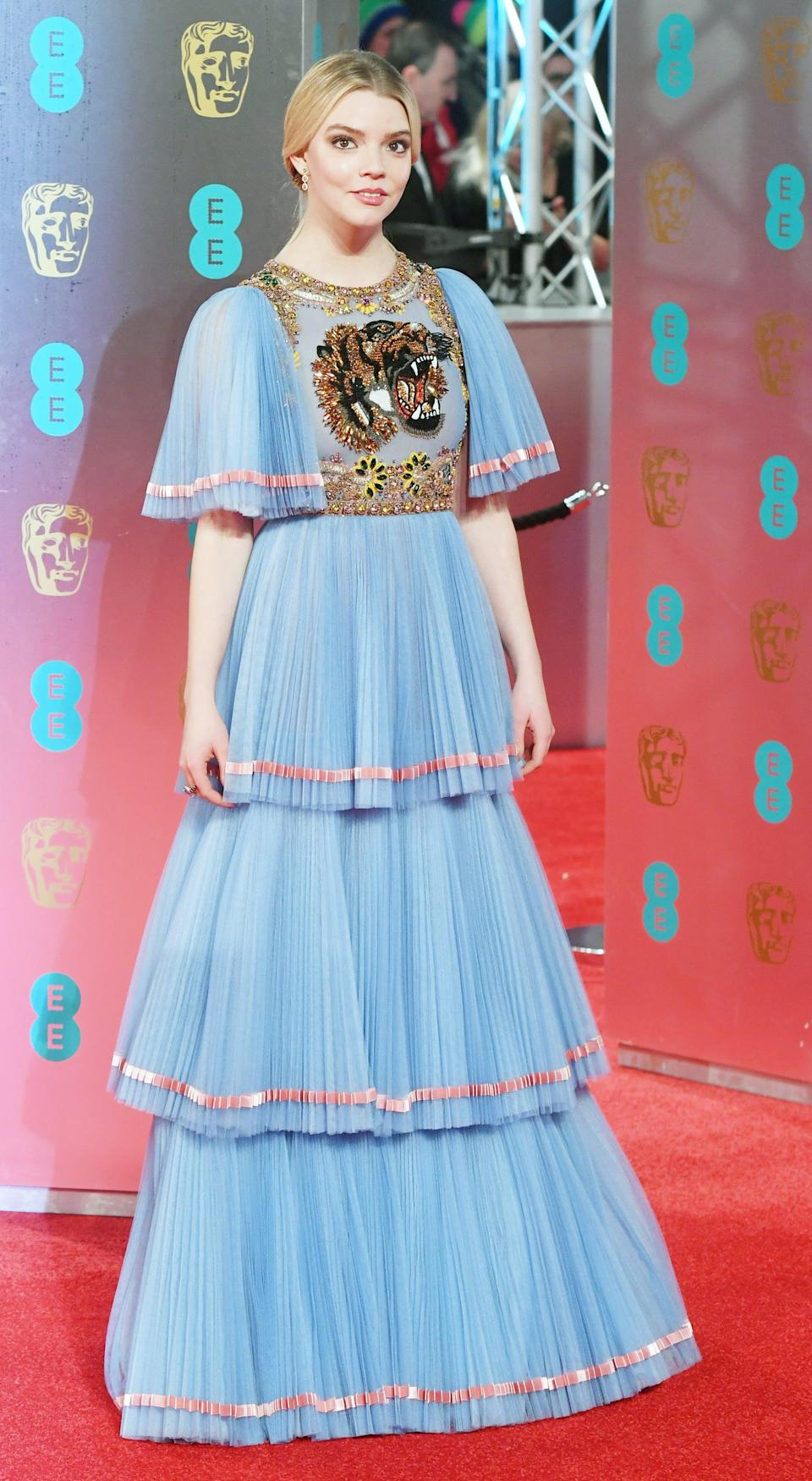 <p>Anya wore a tiered, tulle Gucci gown in light blue with tiger applique detail.</p>
