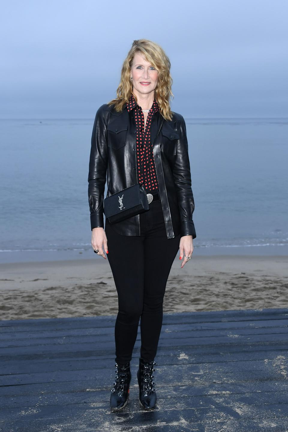 Laura Dern also bagged a front row spot at the Saint Laurent men's SS20 collections in a chic leather jacket, jeans and ankle boots - all by the fashion house of course. <em>[Photo: Getty]</em>