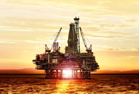 oil rig at sunset.