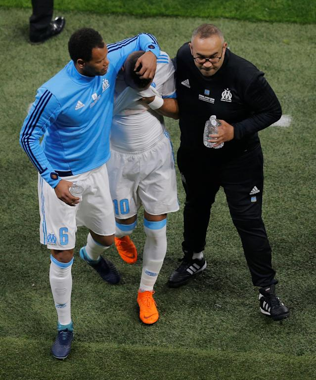 Soccer Football - Europa League Final - Olympique de Marseille vs Atletico Madrid - Groupama Stadium, Lyon, France - May 16, 2018 Marseille's Dimitri Payet is consoled by substitute Rolando as he leaves the pitch in tears after sustaining an injury REUTERS/Vincent Kessler