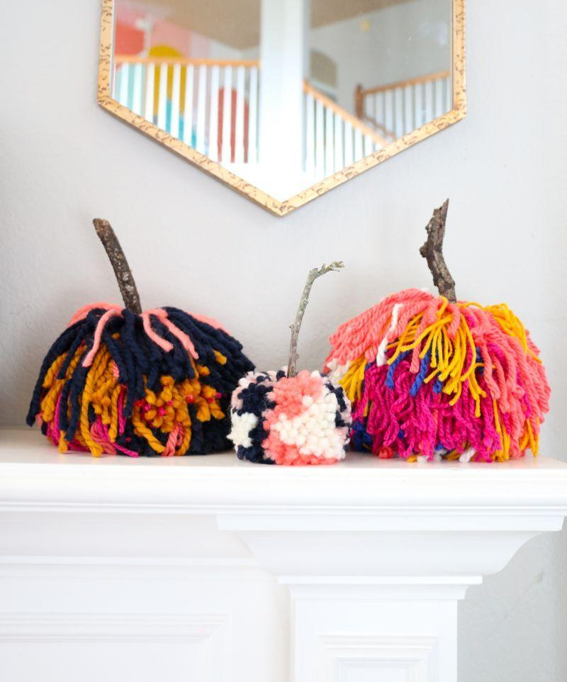 """<p>Since your pumpkin carving days are long gone (until next year, that is), try your hand at these DIY yarn beauties that you can stick on your mantle for years to come. </p><p><em><a href=""""https://akailochiclife.com/2018/09/diy-large-pom-pom-pumpkins.html"""" rel=""""nofollow noopener"""" target=""""_blank"""" data-ylk=""""slk:Get the tutorial at A Kailo Chic Life »"""" class=""""link rapid-noclick-resp"""">Get the tutorial at A Kailo Chic Life »</a></em></p><p><strong>RELATED:</strong> <a href=""""https://www.goodhousekeeping.com/holidays/halloween-ideas/g1714/no-carve-pumpkin-decorating/"""" rel=""""nofollow noopener"""" target=""""_blank"""" data-ylk=""""slk:Best No-Carve Pumpkin Ideas"""" class=""""link rapid-noclick-resp"""">Best No-Carve Pumpkin Ideas </a></p>"""