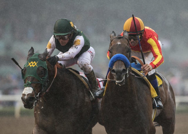 In a photo provided by Benoit Photo, Bolt d'Oro, left, with Javier Castellano up, left, battles McKinzie and Mike Smith down the stretch, before being declared the winner after McKinzie, who finished first, was disqualified and placed second in the Grade II $400,000 San Felipe Stakes horse race Saturday, March 10, 2018, at Santa Anita in Arcadia, Calif. (Benoit Photo via AP)