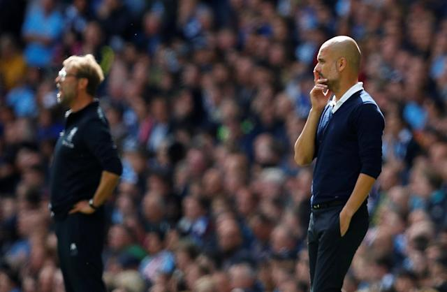 <p>Manchester City manager Pep Guardiola and Liverpool manager Juergen Klopp look on </p>