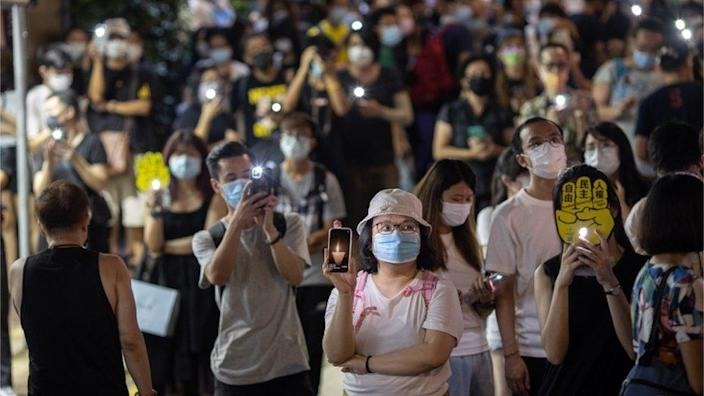People hold their phone lights aloft to mark Tiananmen Square anniversary, June 2021