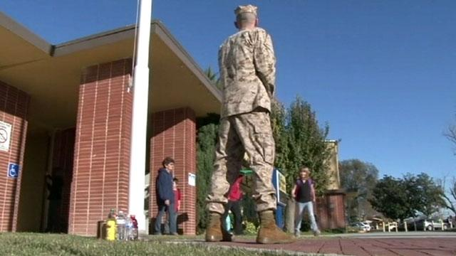 Uniformed Dads Stand Guard at Kids' Schools