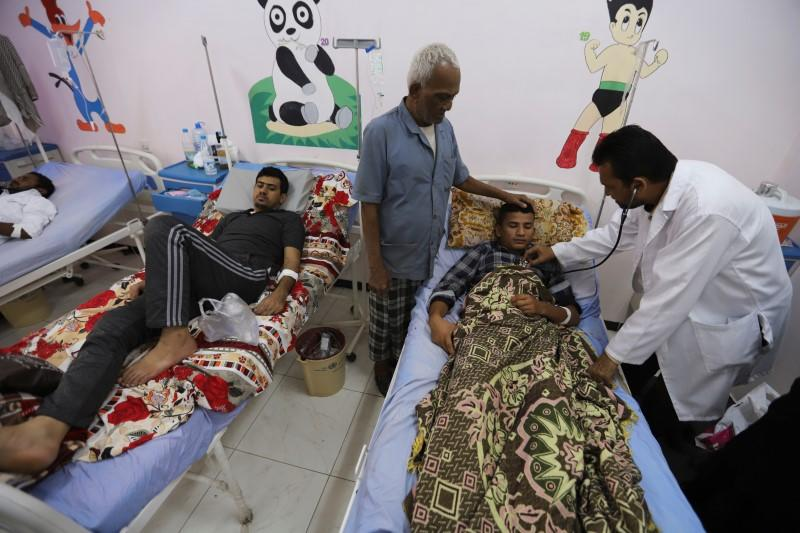 People recuperate from dengue fever at a hospital in Hodeidah