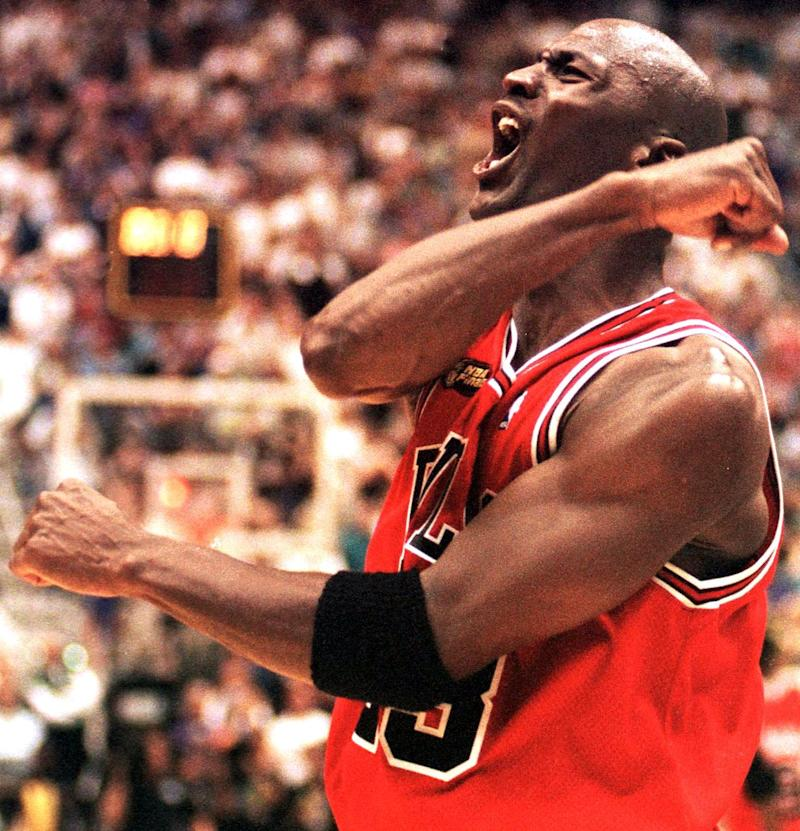 Michael Jordan of the Chicago Bulls celebrates after winning game six of the NBA Finals.