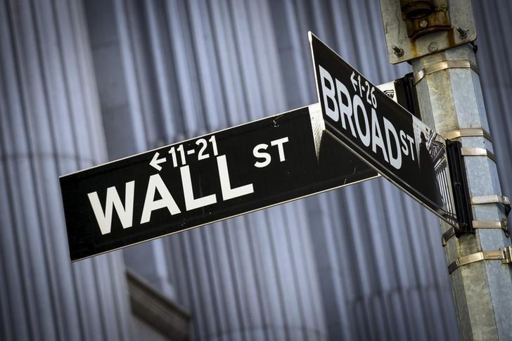 Street signs for Wall St. and Broad St. hang at the corner outside the New York Stock Exchange