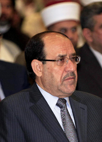 Iraqi Prime Minister Nouri al-Maliki attends the Convergence of religions conference in Baghdad, Iraq, Saturday, April 27, 2013. Gunmen killed 10 people in Iraq, including five soldiers near the main Sunni protest camp west of Baghdad, the latest in a wave of violence that has raised fears the country faces a new round of sectarian bloodshed. The attack on the army intelligence soldiers in the former insurgent stronghold of Ramadi drew a quick response from al-Maliki, whose Shiite-led government has been the target of rising Sunni anger over perceived mistreatment.(AP Photo/Karim Kadim)