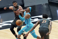 Charlotte Hornets' Devonte' Graham, center, is fouled by Chicago Bulls' Thaddeus Young (21) as Bulls' Garrett Temple also defends during the first half of an NBA basketball game Thursday, April 22, 2021, in Chicago. (AP Photo/Charles Rex Arbogast)
