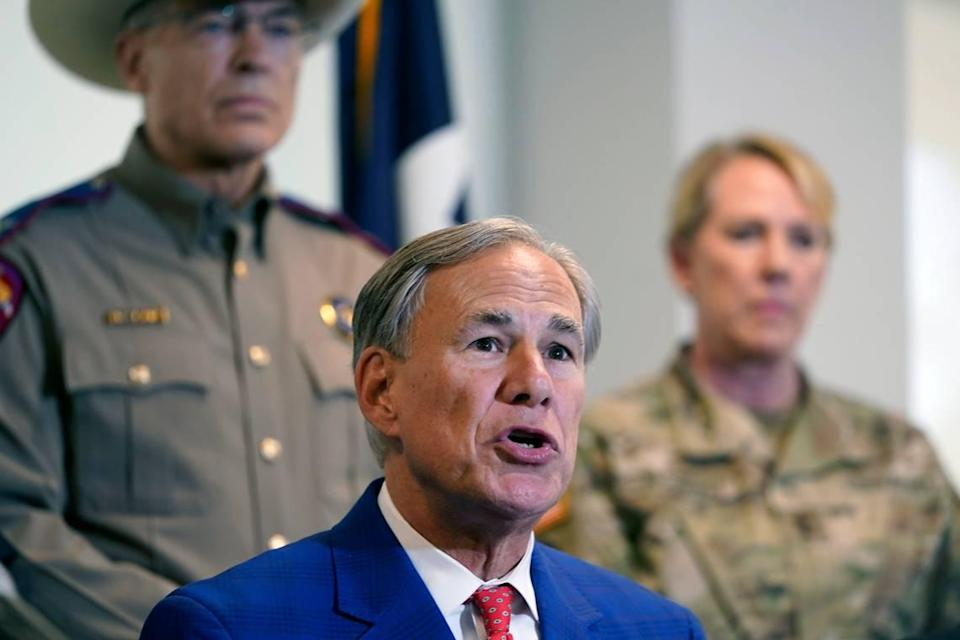 Gov. Greg Abbott speaks with Texas Department of Public Safety Director Steven McCraw and Texas National Guard Director Maj. Gen. Tracy Norris behind him Friday in Fort Worth. Abbott signed a bill providing $2 billion for border security and drug enforcement.