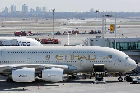 An Etihad plane stands parked at a gate at JFK International Airport in New York, U.S., March 21, 2017.  REUTERS/Lucas Jackson