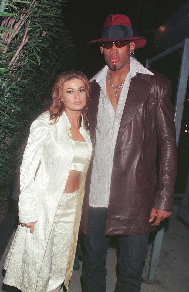 """<p>Although their marriage was short-lived, Rodman's relationship with <a class=""""sugar-inline-link ga-track"""" title=""""Latest photos and news for Carmen Electra"""" href=""""https://www.popsugar.com/Carmen-Electra"""" target=""""_blank"""" data-ga-category=""""Related"""" data-ga-label=""""https://www.popsugar.com/Carmen-Electra"""" data-ga-action=""""&lt;-related-&gt; Links"""">Carmen Electra</a> will forever be an iconic '90s moment. <a href=""""http://people.com/celebrity/rodmans-to-divorce/"""" target=""""_blank"""" class=""""ga-track"""" data-ga-category=""""Related"""" data-ga-label=""""http://people.com/celebrity/rodmans-to-divorce/"""" data-ga-action=""""In-Line Links"""">The pair tied the knot</a> in Las Vegas on Nov. 14, 1998, after a night out on the town. </p> <p>Nine days later, Rodman filed for an annulment of the marriage, claiming he had """"not been of sound mind"""" when they wed. After the filing, the couple briefly reconciled and attempted to work things out through early 1999. By March, however, they officially filed for divorce.</p>"""