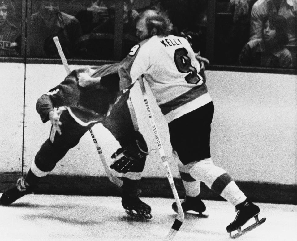 FILE - In this Feb. 2, 1974, file photo, Philadelphia Flyers leftwinger Bob Kelly (9) and Larry Johnson (3) of the Detroit Red Wings square off for a few moments in the first period of an NHL game, in Philadelphia. In the 1970s, the Philadelphia Flyers had guys like Dave The Hammer Schultz, Bob The Hound Kelly and Andre Moose Dupont around to not just beat opponents but beat them up, too. More than 40 years later, the Flyers still carry the Bullies nickname but are hardly bullying anyone: Theyre one of only two teams in the NHL without a fight a quarter of the way through the season. (AP Photo/Rusty Kennedy, FIle)