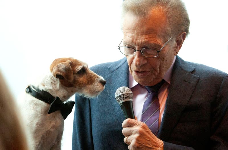 """FILE PHOTO: Uggie, the dog from the film """"The Artist"""", is interviewed by Larry King before the start of the Friars Club Roast of Betty White in New York"""