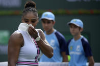 Serena Williams leaves the court, retiring with a medical issue, during her match against Garbine Muguruza, of Spain, at the BNP Paribas Open tennis tournament Sunday, March 10, 2019, in Indian Wells, Calif. (AP Photo/Mark J. Terrill)
