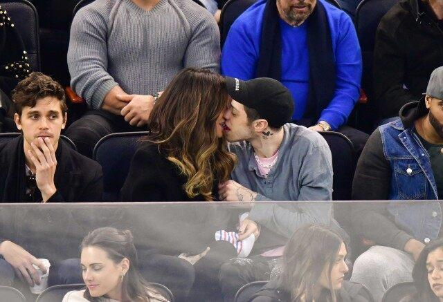 Pete Davidson and Kate Beckinsale kissing at a New York Rangers game
