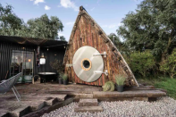 "<p>We love this eco-friendly Airbnb, which is a converted 1945 boat (it originally sailed out of Penzance in Cornwall). Enclosed within a private three-acre forest, this <a href=""https://www.housebeautiful.com/uk/lifestyle/property/"" rel=""nofollow noopener"" target=""_blank"" data-ylk=""slk:property"" class=""link rapid-noclick-resp"">property</a> is nestled within its own pocket of nature. With an outdoor bath, roaring fireplace and a deeply charming facade, it truly couldn't provide a more comforting stay. </p><p><a class=""link rapid-noclick-resp"" href=""https://airbnb.pvxt.net/ORr2VA"" rel=""nofollow noopener"" target=""_blank"" data-ylk=""slk:BOOK NOW"">BOOK NOW</a><br></p>"
