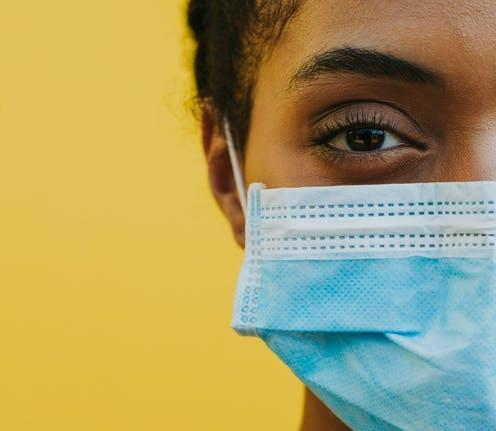 "<span class=""attribution""><a class=""link rapid-noclick-resp"" href=""https://www.shutterstock.com/image-photo/african-american-woman-wearing-medical-mask-1793657722"" rel=""nofollow noopener"" target=""_blank"" data-ylk=""slk:oneinchpunch/Shutterstock"">oneinchpunch/Shutterstock</a></span>"
