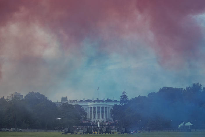 "The White House in obscured by Red and Blue smoke floating on the Ellipse during a ""Salute to America"" event on the South Lawn of the White House, Saturday, July 4, 2020, in Washington. (AP Photo/Alex Brandon)"