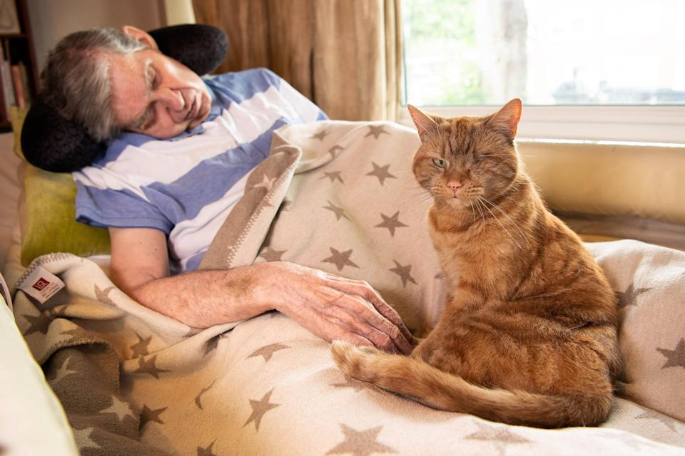 Boris the cat with his owner Alex (Jeff Spicer/PA)