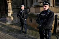 FILE PHOTO: Armed police officers stand on duty outside the Houses of Parliament in Westminster, central London November 24, 2014. REUTERS/Andrew Winning/File Photo