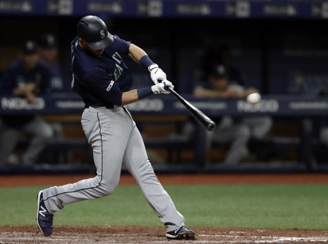 Seattle Mariners' Austin Nola lines an RBI single off Tampa Bay Rays relief pitcher Jalen Beeks during the fifth inning of a baseball game Tuesday, Aug. 20, 2019, in St. Petersburg, Fla. (AP Photo/Chris O'Meara)