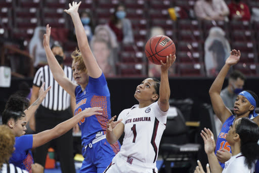 South Carolina guard Zia Cooke (1) attempts to shoot against Florida forward Floor Toonders, left, during the first half of an NCAA college basketball game Thursday, Dec. 31, 2020, in Columbia, S.C. (AP Photo/Sean Rayford)