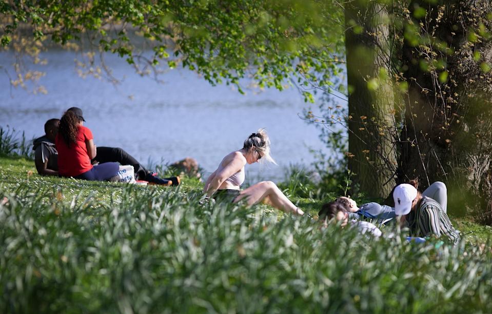 LONDON, ENGLAND - APRIL 10: Sunbathers in Regents Park, Good Friday on April 10, 2020 in London. There have been around 70,000 reported cases of the COVID-19 coronavirus in the United Kingdom and over 7,000 deaths. The country is in its third week of lockdown measures aimed at slowing the spread of the virus. (Photo by Jo Hale/Getty Images)