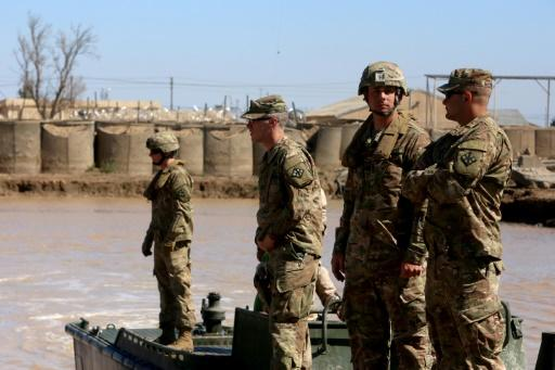 US troops supervise a training session at the Taji camp, north of Baghdad - the site of the Wednesday night rocket attack which killed a British soldier and two US personnel