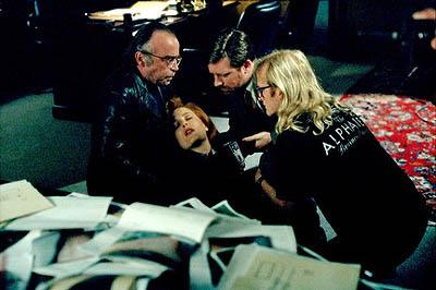 "Scully (Gillian Anderson, C) is saved from a fall by The Lone Gunmen (L-R: Tom Braidwood as Frohike, Bruce Harwood as Byers and Dean Haglund as Langly) in the ""Requiem"" episode of Fox's The X-Files X-Files"