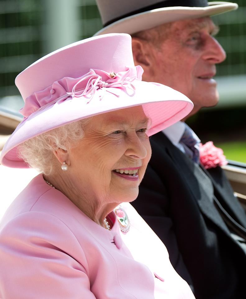 ASCOT, ENGLAND - JUNE 20:  Queen Elizabeth II and Prince Philip, Duke of Edinburgh arrive by carriage on day 2 of Royal Ascot 2012 at Ascot Racecourse on June 20, 2012 in Ascot, United Kingdom. (Photo by Samir Hussein/WireImage)