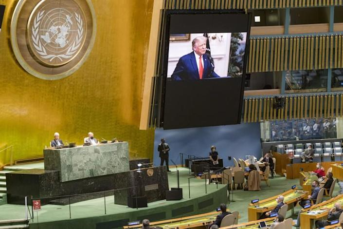In this photo provided by the United Nations, U.S. President Donald Trump, is on video screens as his pre-recorded message is played during the 75th session of the United Nations General Assembly, Tuesday, Sept. 22, 2020, at UN Headquarters in New York. The U.N.'s first virtual meeting of world leaders started Tuesday with pre-recorded speeches from some of the planet's biggest powers, kept at home by the coronavirus pandemic that will likely be a dominant theme at their video gathering this year. (UN Photo/Rick Bajornas via AP)