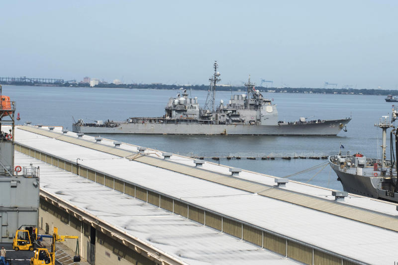 This image provided by the US Navy shows the USS San Jacinto (CG-56) as it heads out of the it's berth at Naval Station Norfolk ahead of Hurricane Dorian in Norfolk, Va., Wednesday Sept. 4, 2019. The U.S. Navy has ordered ships based on Virginia's coast to head out to sea to avoid Hurricane Dorian. (Alton Dunham/US Navy via AP)