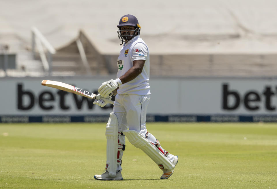 Sri Lanka's batsman Kusal Perera leaves the field after being dismissed by South Africa's bowler Wiaan Mulder for 60 runs during the 2nd Test cricket match between South Africa and Sri Lanka Wanderers stadium in Johannesburg, South Africa, Sunday, Jan. 3, 2021. (AP Photo/Themba Hadebe)