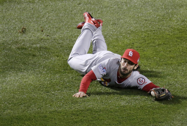 St. Louis Cardinals' Matt Carpenter can't catch a ball hit by Boston Red Sox's David Ortiz during the eighth inning of Game 2 of baseball's World Series Thursday, Oct. 24, 2013, in Boston. (AP Photo/Charlie Riedel)