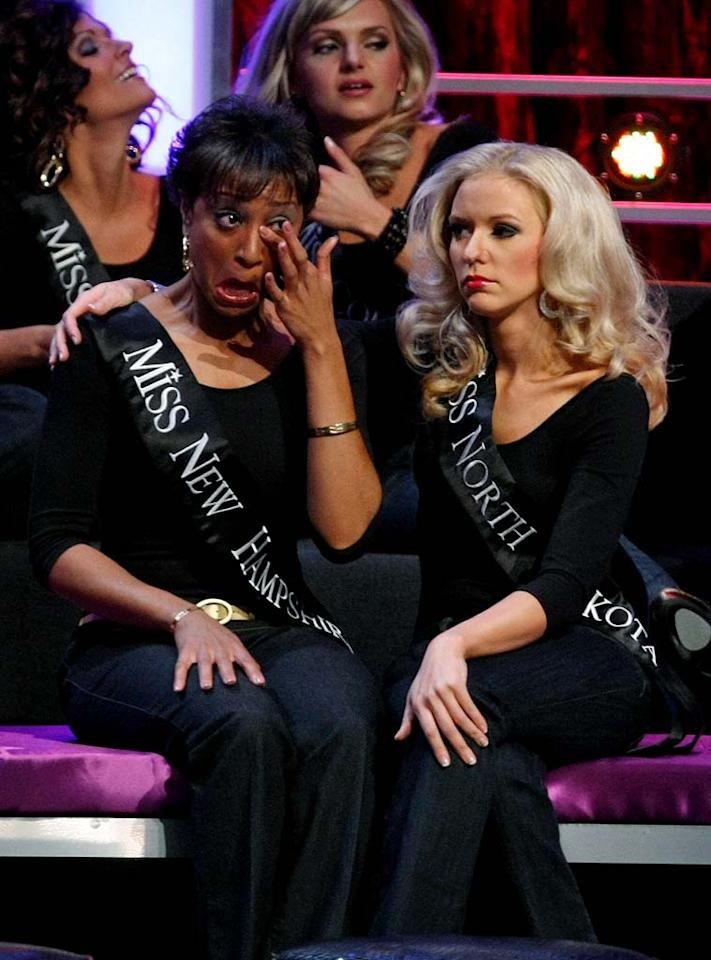 """Natalie C. Shaw (L), Miss New Hampshire, and Tessie Jones, Miss North Dakota, react after being eliminated from the <a href=""""/miss-america-countdown-to-the-crown/show/44013"""">2009 Miss America Pageant</a> at the Planet Hollywood Resort & Casino January 24, 2009 in Las Vegas, Nevada."""