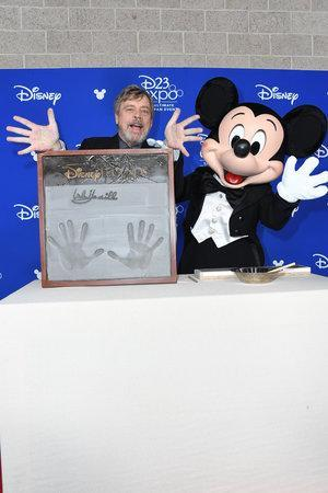 <p>The <em>Star Wars</em> star's handprints are immortalized in concrete during the Disney Legends ceremony. (Photo: Disney) </p>