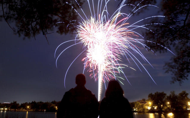 <p>People watch fireworks at Sloans Lake in Lions Park during the celebration of Independence Day, Wednesday, July 4, 2018, in Cheyenne, Wyo. (Photo: Jacob Byk/The Wyoming Tribune Eagle via AP) </p>