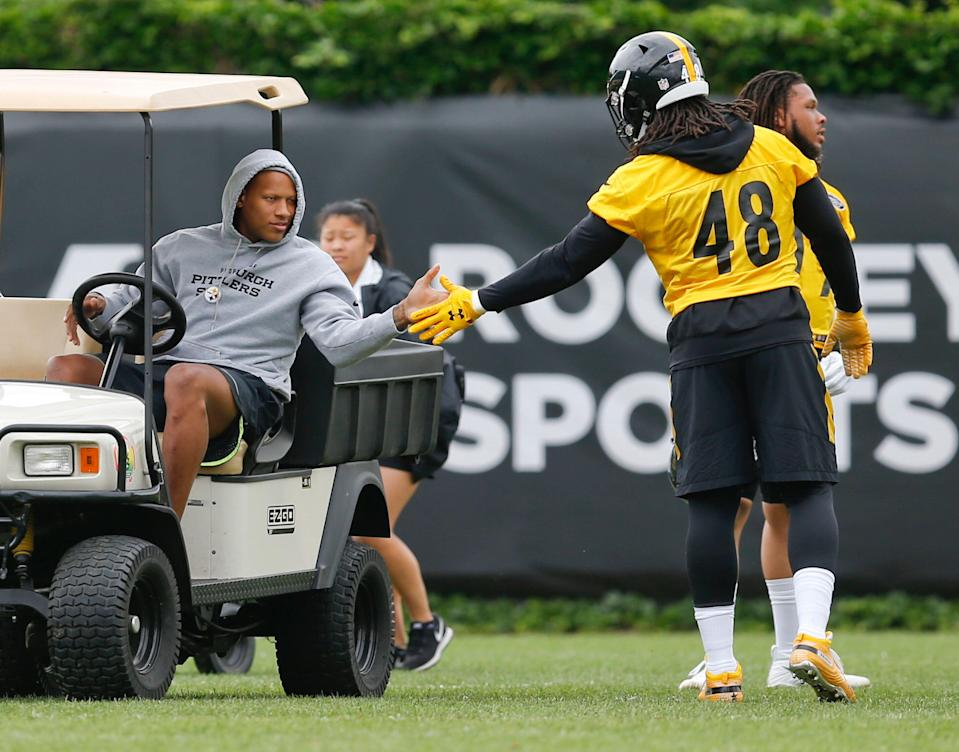 Pittsburgh Steelers linebacker Bud Dupree (48) greets injured teammate Ryan Shazier during an NFL football practice, Wednesday, June 6, 2018, in Pittsburgh. (AP Photo/ Photo/Keith Srakocic)