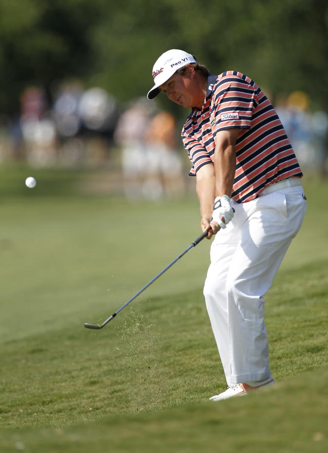 Jason Dufner chips onto the 16th green during the second round of the PGA Byron Nelson Championship golf tournament Friday, May 18, 2012, in Irving, Texas. Dufner finished with a two-round score of 7-under-par (AP Photo/Tony Gutierrez)